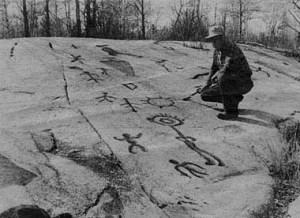 Peterborugh Petroglyphs with man examining